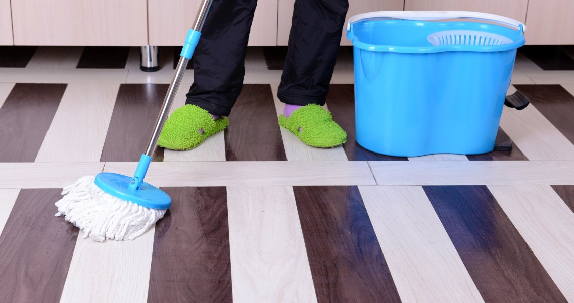 Here's How to Mop Wood Floors & Keep