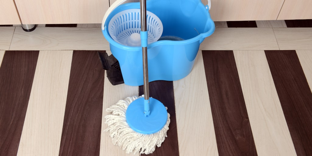 Here's How to Mop Wood Floors & Keep Them Looking Great