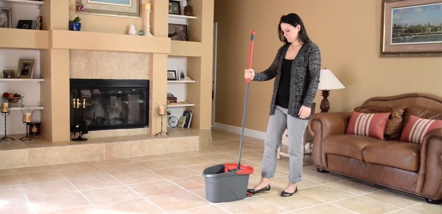 Woman with a spin mop