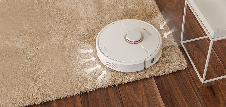 Hybrid robotic vacuum and mop on the carpet.