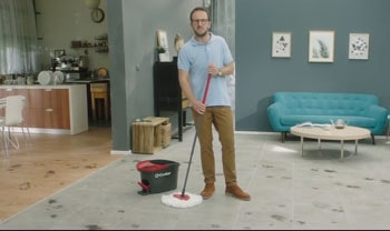 Man with a spin mop.