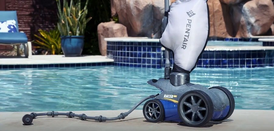 Pentair Pressure Side Pool Cleaner near the pool.