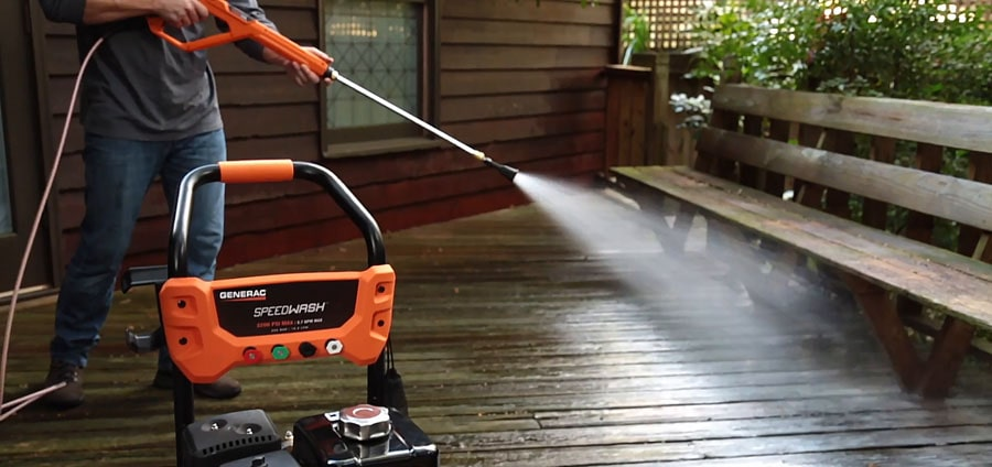Man washing the patio with the gas pressure washer.