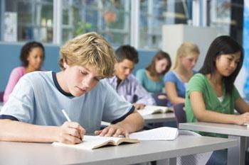 High school student writting an essay.