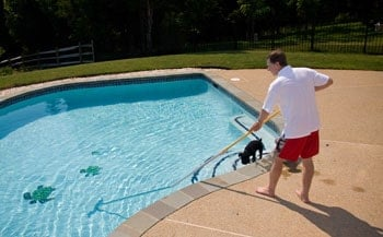 Man with a pool brush.