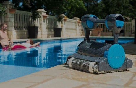 Robotic pool cleaner standing near the pool.