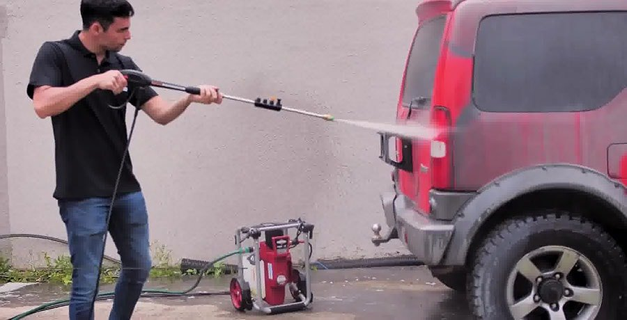 Man washes his car using Briggs&Stratton S2000 electric pressure washer.