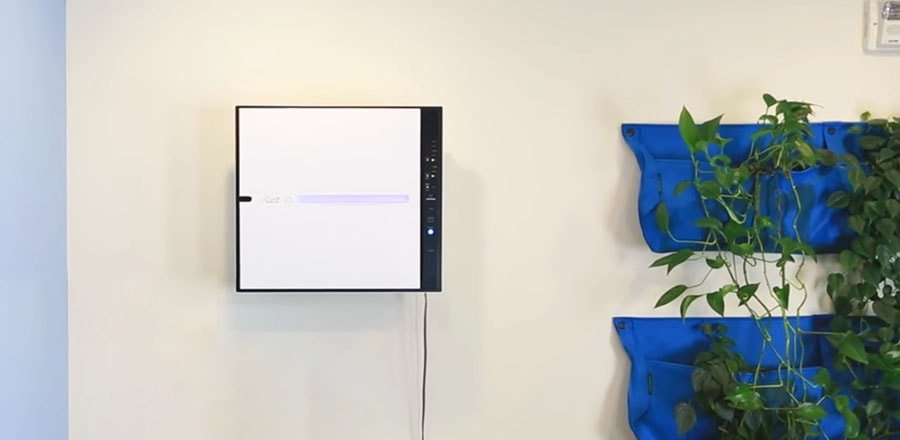 RabbitAir MinusA2 indoor air purifier hanging on the wall.
