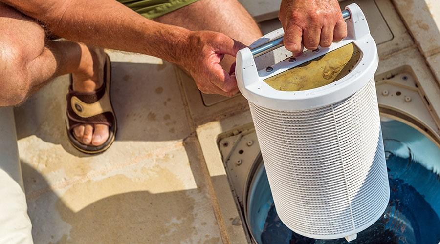 Man installs a pool filter.