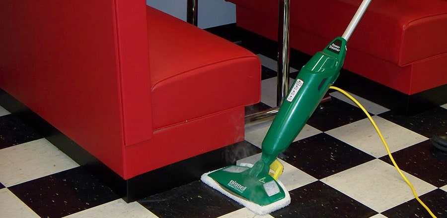 BISSELL BigGreen Commercial at cleaning of the tiling floor.