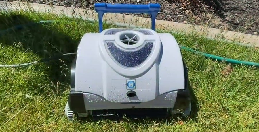 Hayward SharkVac on a yard's grass after it finished the work.