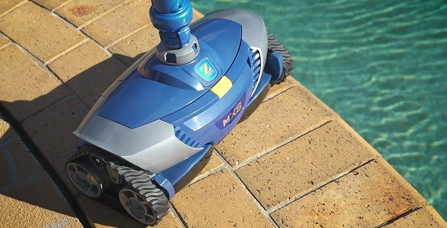 Zodiac MX8 Suction Pool Cleaner standing near the pool