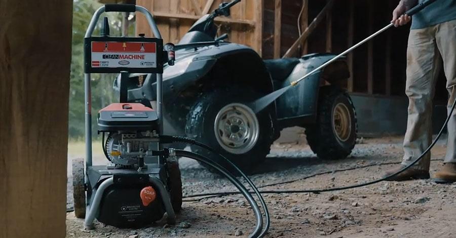 Man cleans his quad using Simpson CM61016.