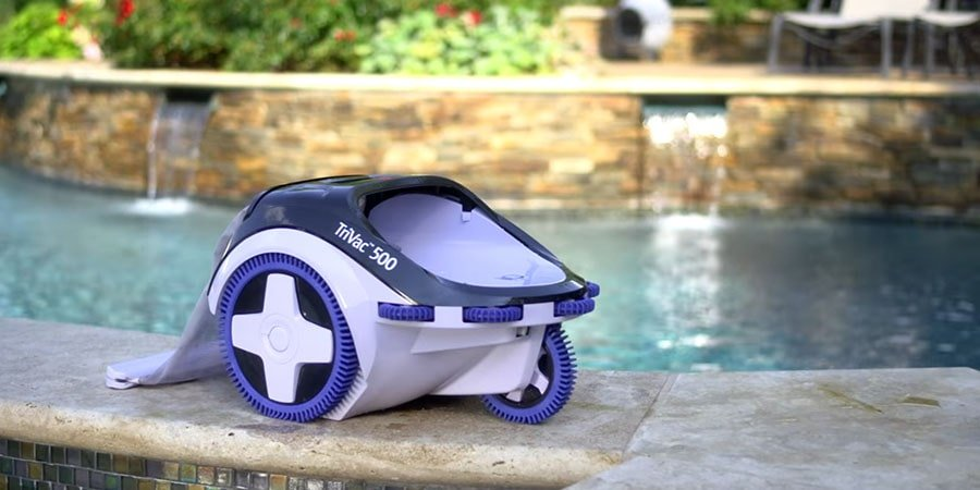 Hayward TriVac 500 Pressure Side Pool Cleaner stands near the pool.