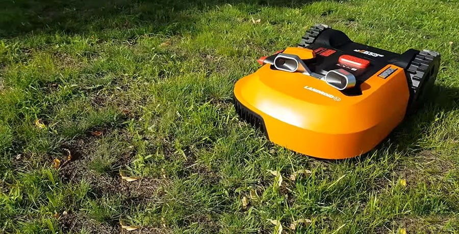 Worx WR140 Landroid (with the optional Anti-Collision System installed) mows the lawn.