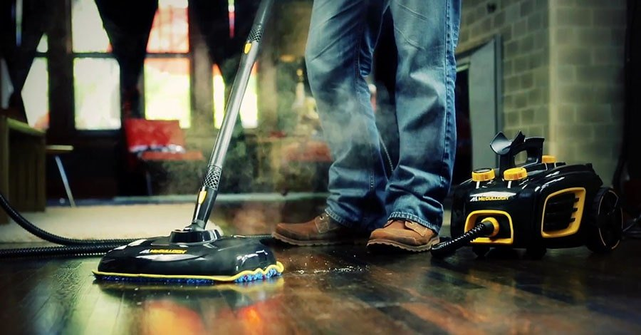 Man cleans hardwood floor with the McCulloch MC1375.